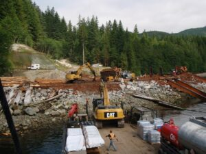 Unloading an excavator at a working log sort.